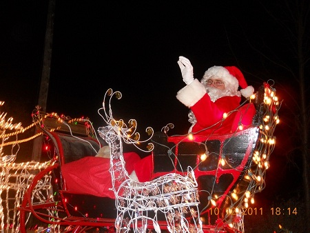 Santa Claus waiving on top of float