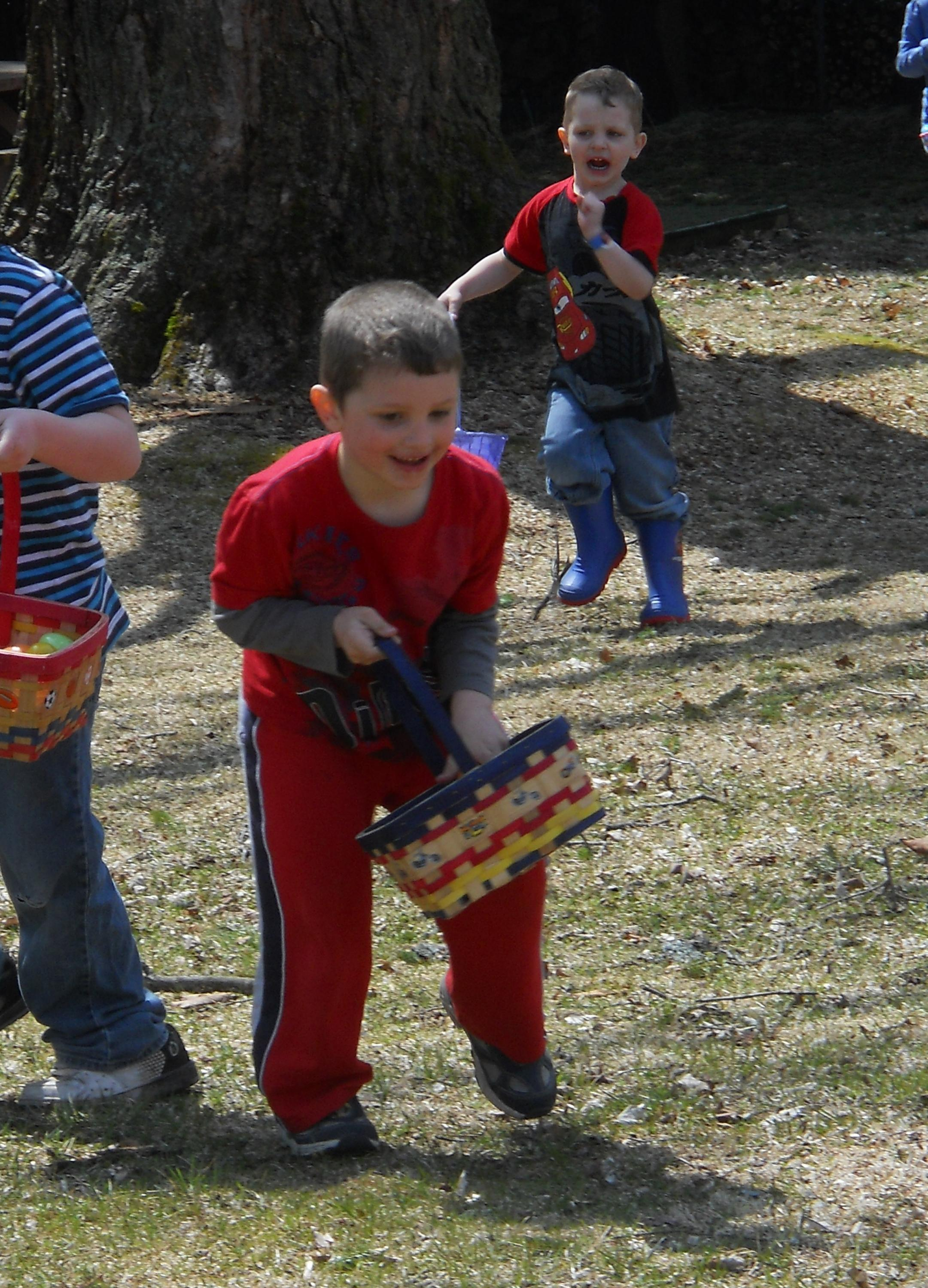 small excited children collecting Easter eggs