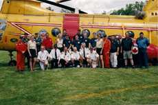Group of people infront of Search and Rescue Helicopter