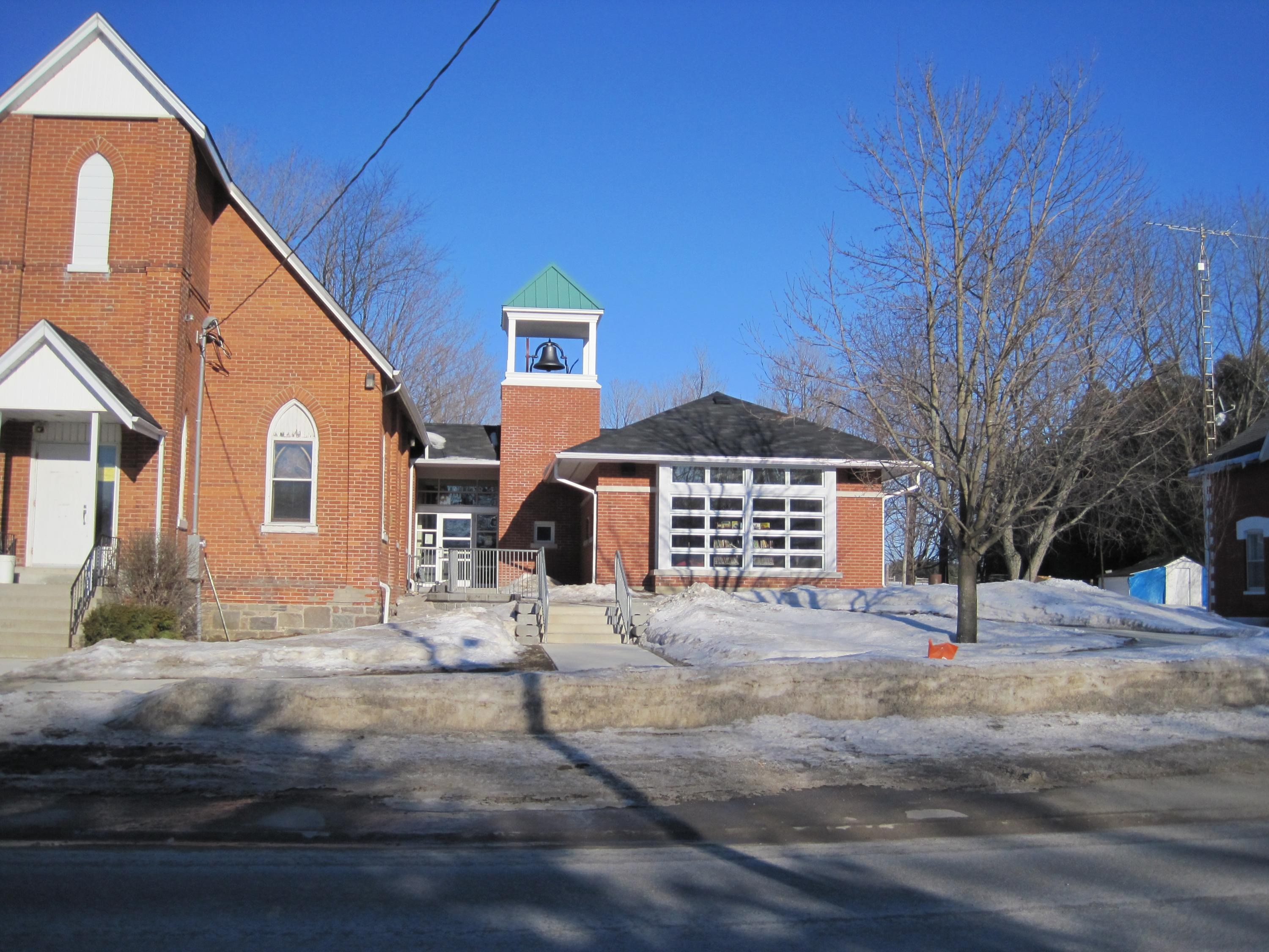 Front of Centrenton Community Hall on a sunny day with snow on the ground
