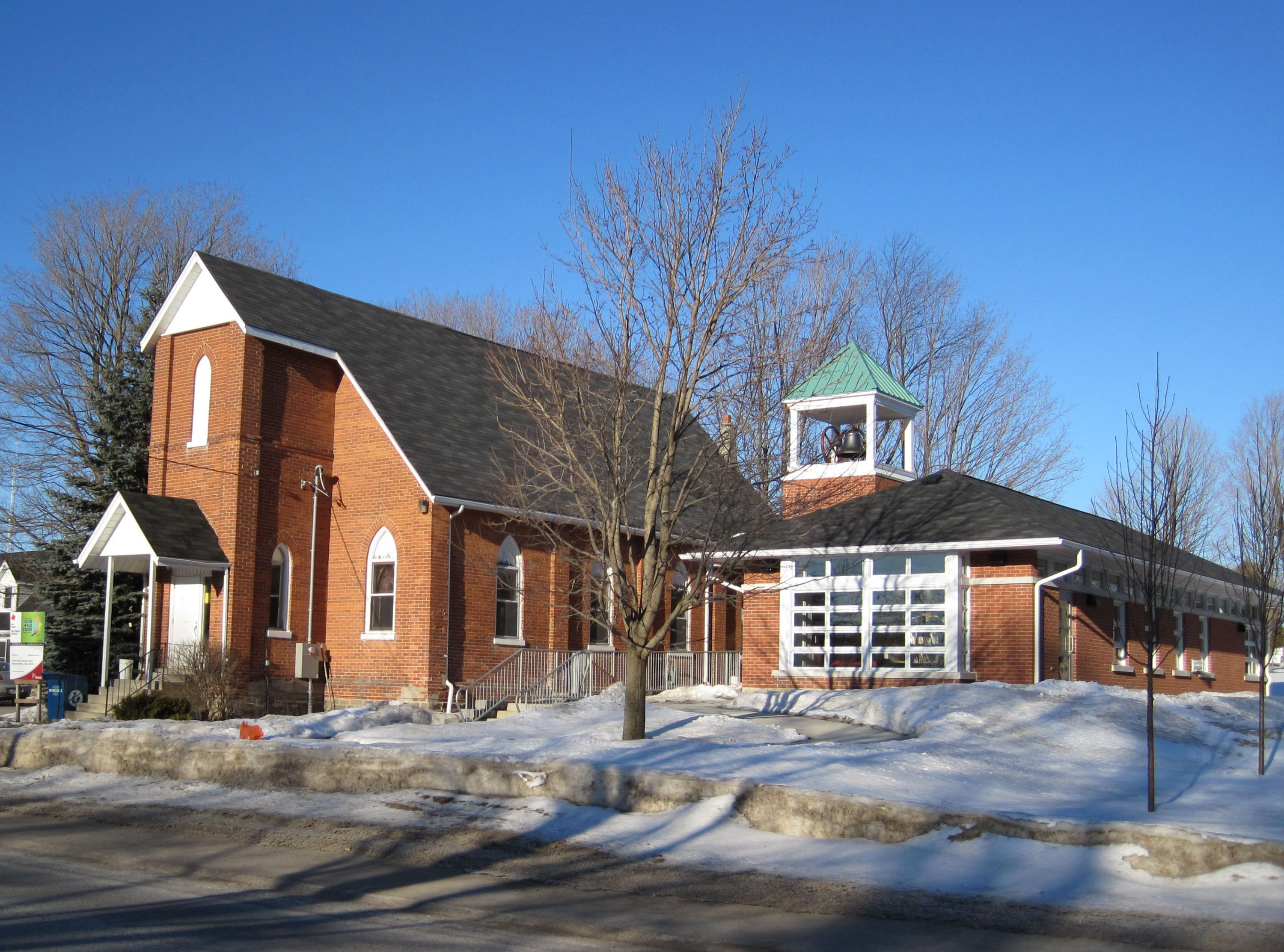 side of Centrenton Community Hall on a sunny day with snow on the ground