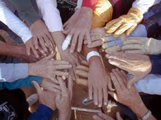 group of various peoples hands placed together to symbolize team effort